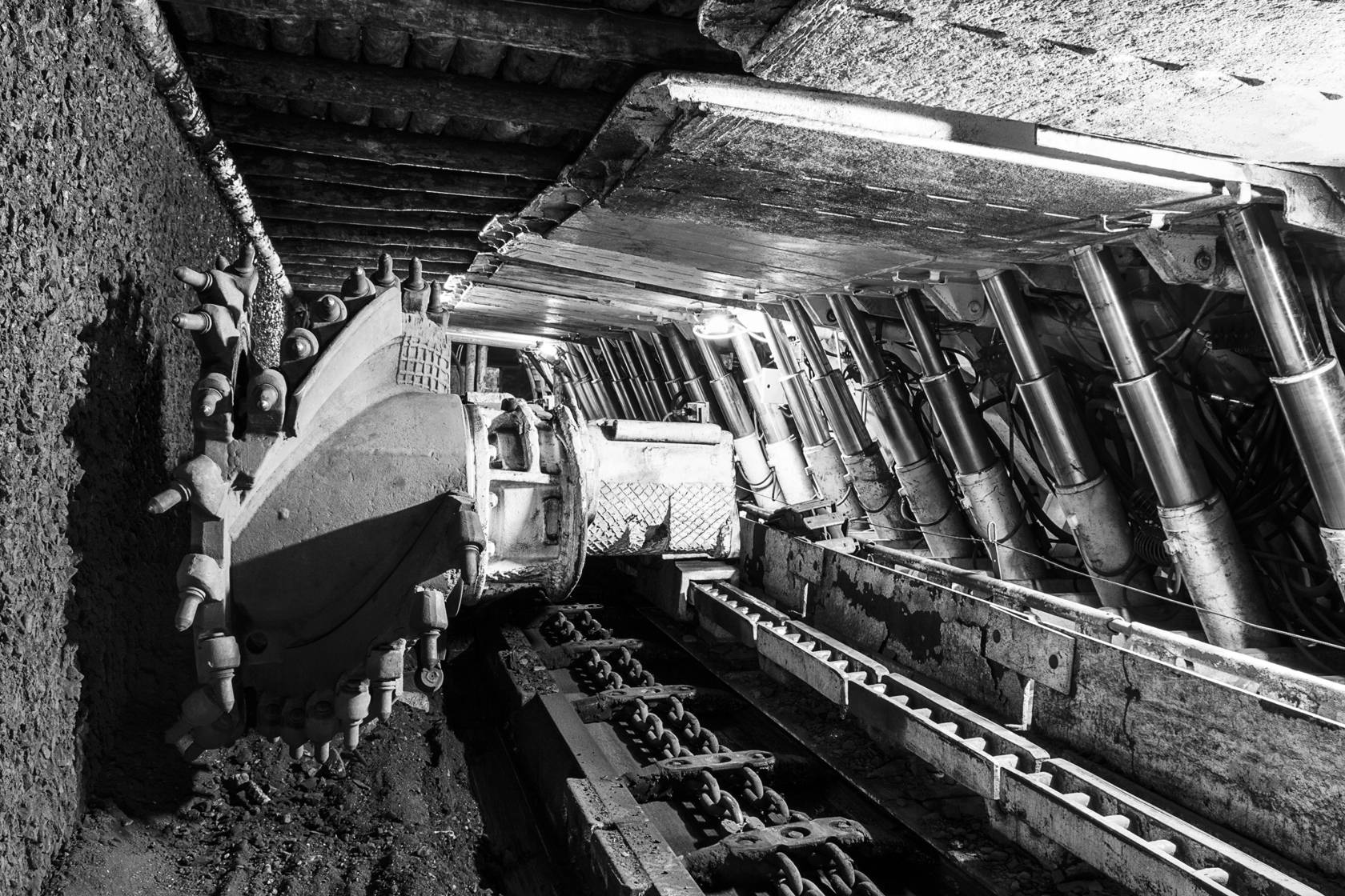 Longwall Mining: Shearer, with two rotating cutting drums and movable hydraulic powered roof supports called shields.
