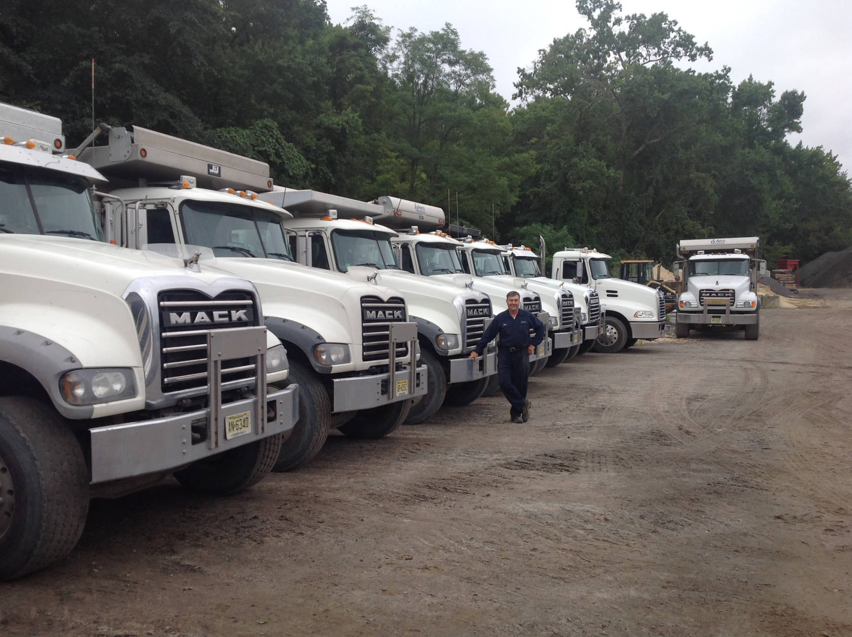 Bruce Stelljes with part of this fleet at the  truck yard in Wrightstown, New Jersey.