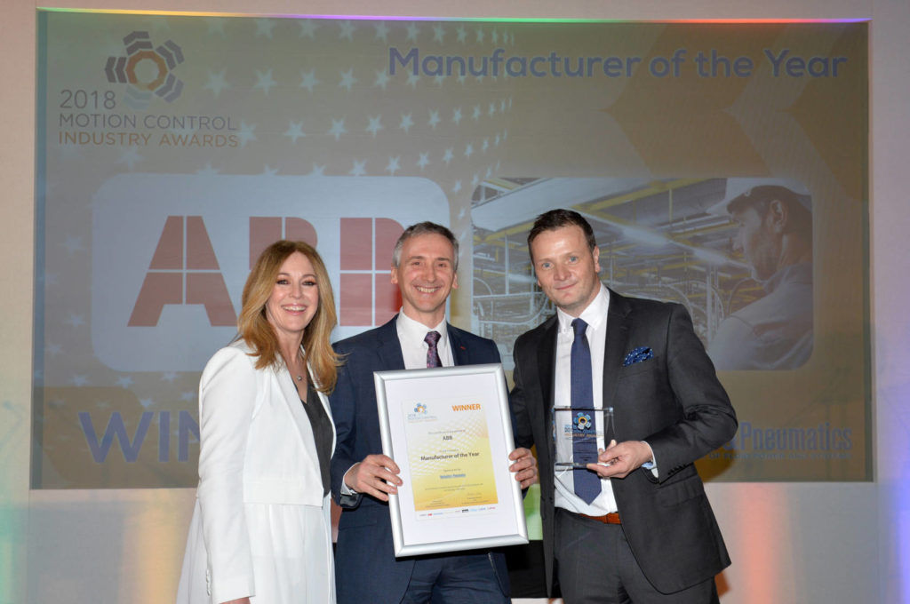 Andy Preston of ABB accepts the MCI Manufacturer of the Year award from Helen Fospero, host, and Ryan Fuller of category sponsor Hydraulics & Pneumatics magazine