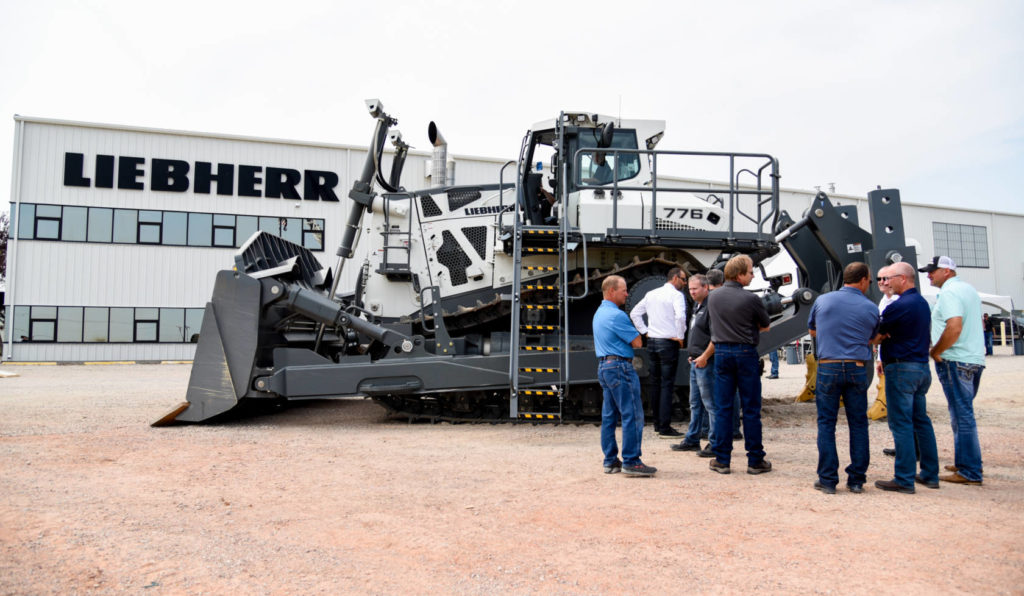 Crowd of customers discuss the PR 776 with product specialists