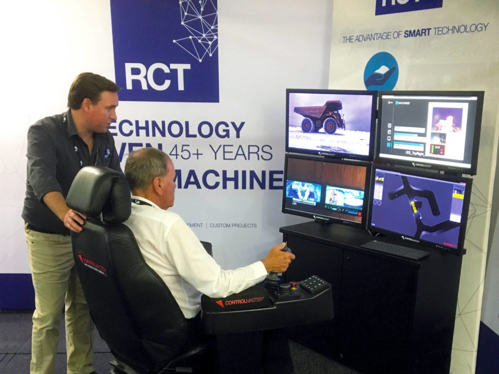 Kalgoorlie Mayor John Bowler operates the Automation Centre at RCT's stall at the expo.